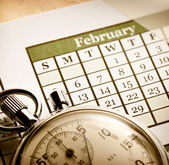 Monthly calendar and stopwatch — Stock Photo
