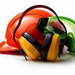 Stock Photo: Red safety helmet with earphones and goggles