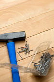 Hammer with the heap of nails — Stock Photo