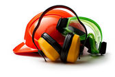 Red safety helmet with earphones and goggles — Stok fotoğraf