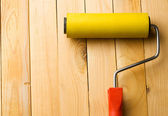 Roller isolated on wooden background — Stock Photo