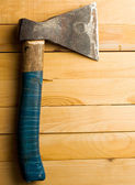 Axe isolated on wooden background — Stock Photo