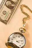 Watch and dollar — Stock Photo