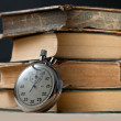 Old books and stopwatch — Stock Photo