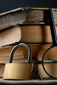 Old books and keylock — Stock Photo