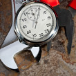Stock Photo: Spanner, pliers and stopwatch
