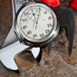 Spanner, pliers and stopwatch — Stock Photo