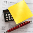 Tax form, red pen, calculator and sticker — Stock Photo #9287956