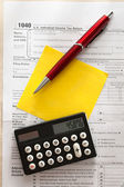 Tax form, red pen, calculator and sticker — Stock Photo