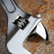 Spanner on the rusty plate — Stock Photo