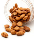 Almonds in the plastic jar on white — Stock Photo