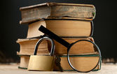 Old books with keylock — Stock Photo