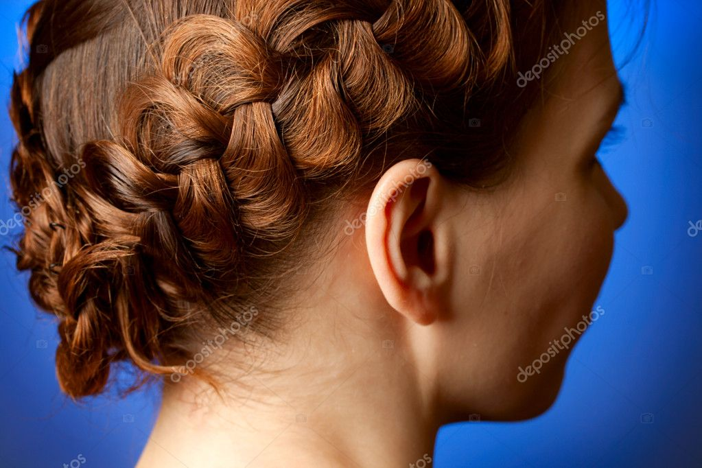 Modern hairdo with plaits sideview — Stock Photo #9638645