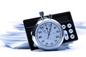 Tas de cartes en papier, calculatrice et chronomètre — Photo