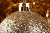 Golden bauble on a gold background. — Stock Photo