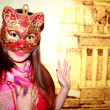 Portrait of a girl in a Venetian mask cat - Stock Photo