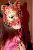 Portrait of a girl in a Venetian mask cat — Stock Photo