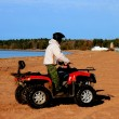 Man on a quad bike - Stock Photo