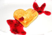 Cheese pancakes in form hearts Love — Stock Photo
