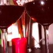Two glasses of red wine next to the candles — Stock Photo #9036426