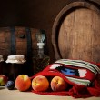 Wooden barrel, jam and fruit — Stock Photo