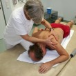 Vojta technique: physiotherapist handling male patient — Stock Photo