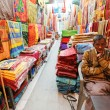 Male shopkeeper- fabric — Stock Photo