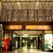 Entrance to department store during christmas celebrations - Stock Photo