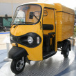 Stock Photo: Yellow three wheeler pickup at autoexpo in delhi, india