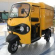 Yellow three wheeler pickup at autoexpo in delhi, india — Stock Photo