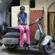 Stock Photo: Little girl sitting on scooter in street, delhi, india