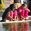 Women in saris performing ablution at Jama Masjid, Delhi, India - Stock Photo
