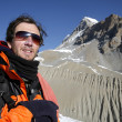 Stock Photo: Mountaineer admiring view after trek