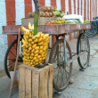 Royalty-Free Stock Photo: A fruit cart with bunch of bananas infront
