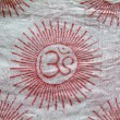 OM design on indian scarf cloth - Stock Photo