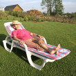 Stock Photo: Wompensioner enjoying her free time in garden