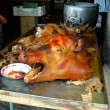 Grilled pig head with mouth open, banos, ecuador — Stock Photo