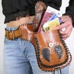Series: woman posing with money belt bag — Stock Photo #8044944