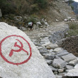 Communist inscription on rock in nepal annapurna trek — Stock Photo