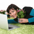 Woman flowers and laptop — Stock Photo