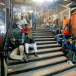 Travellers waiting at Delhi train station — Stock Photo