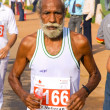 Elderly male sikh marathon runner — Stock Photo
