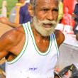 Elderly male marathon runner — Stock Photo #8045554