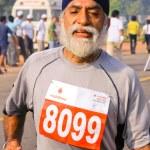 Elderly male marathon runner — Stock Photo #8045558