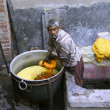Man dyeing fabric in india - Stock Photo