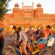 Stock Photo: Men cycling by fort