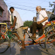 Stock Photo: Rickshaw puller ferrying passenger, delhi, india