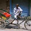 Stock Photo: Rickshaw puller in paharganj, delhi, india