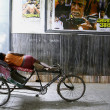 Stock Photo: Rickshaw puller taking snooze, delhi, india