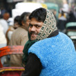 Rickshaw puller looking back, paharganj, delhi — Stock Photo